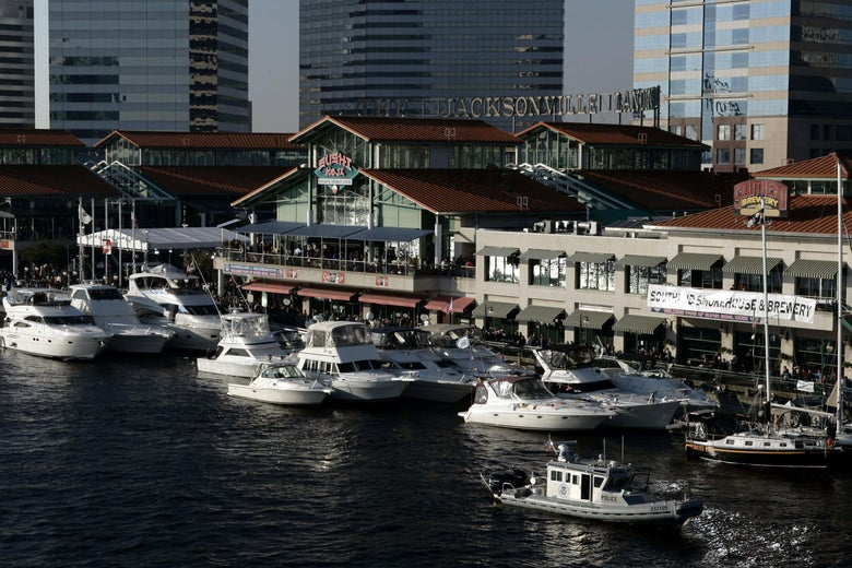 The Jacksonville Landing complex with boats in front of it.