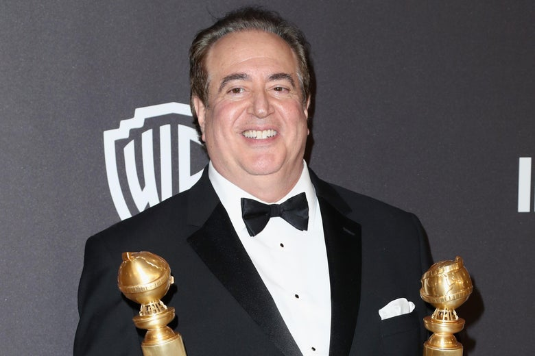 Nick Vallelonga holding his Golden Globes.