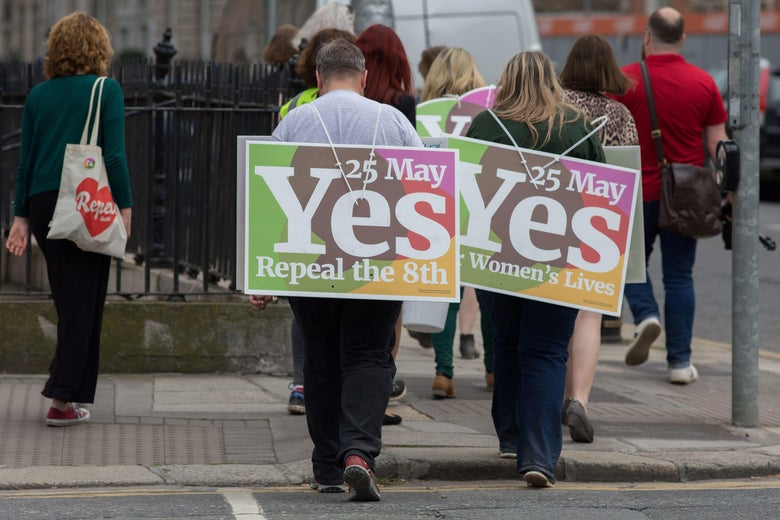 Activists from the 'Yes' campaign, urging people to vote 'yes' in the referendum to repeal the eighth amendment of the Irish constitution, canvas voeters in Dublin on May 24, 2018. - Ireland will hold a referendum on May 25 on whether to alter its constitution to legalise abortion. The Eighth Amendment of the Irish constitution recognises the equal right to life of the unborn and the mother. Abortion is illegal unless there is a real and substantial risk to the life of the mother, and a woman convicted of having an illegal termination faces 14 years imprisonment. (Photo by BARRY CRONIN / AFP)        (Photo credit should read BARRY CRONIN/AFP/Getty Images)