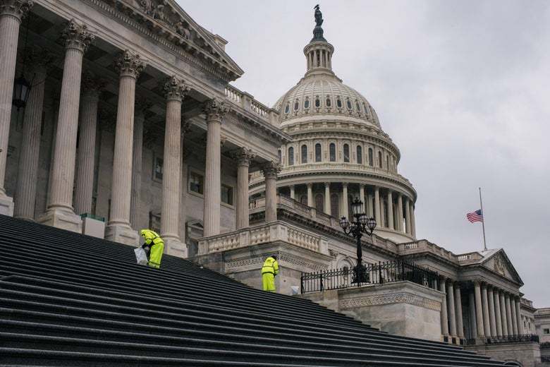 Employees salt the steps leading to the U.S. Capitol following the conclusion of the second impeachment trial of former President Donald Trump.