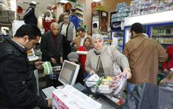 Egyptians queue up in a Cairo supermarket. Click image to expand.