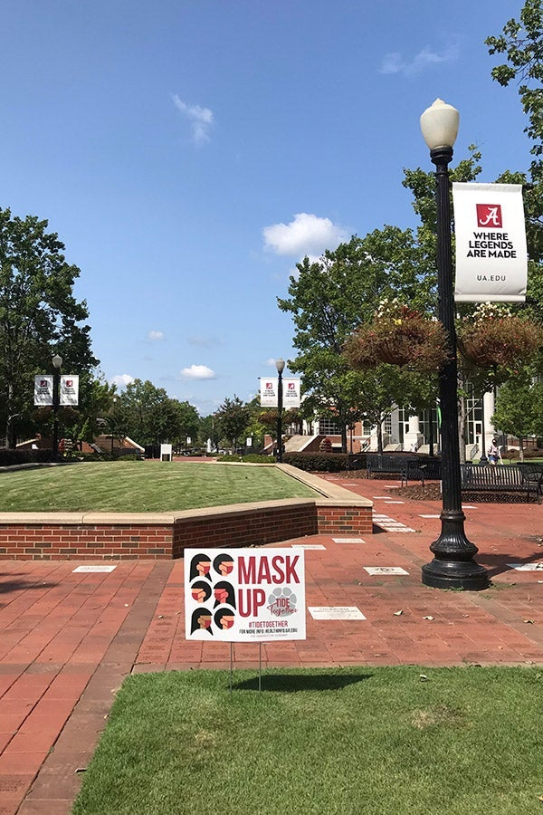 "A ""mask up"" sign on a mostly empty University of Alabama campus."