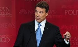 Republican presidential hopeful and Texas Governor Rick Perry speaks during the Republican Presidential Candidates debate. Click image to expand.