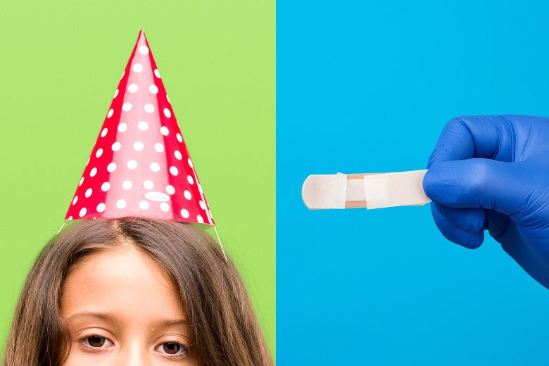 A child in a birthday hat and a gloved hand holding a band-aid.