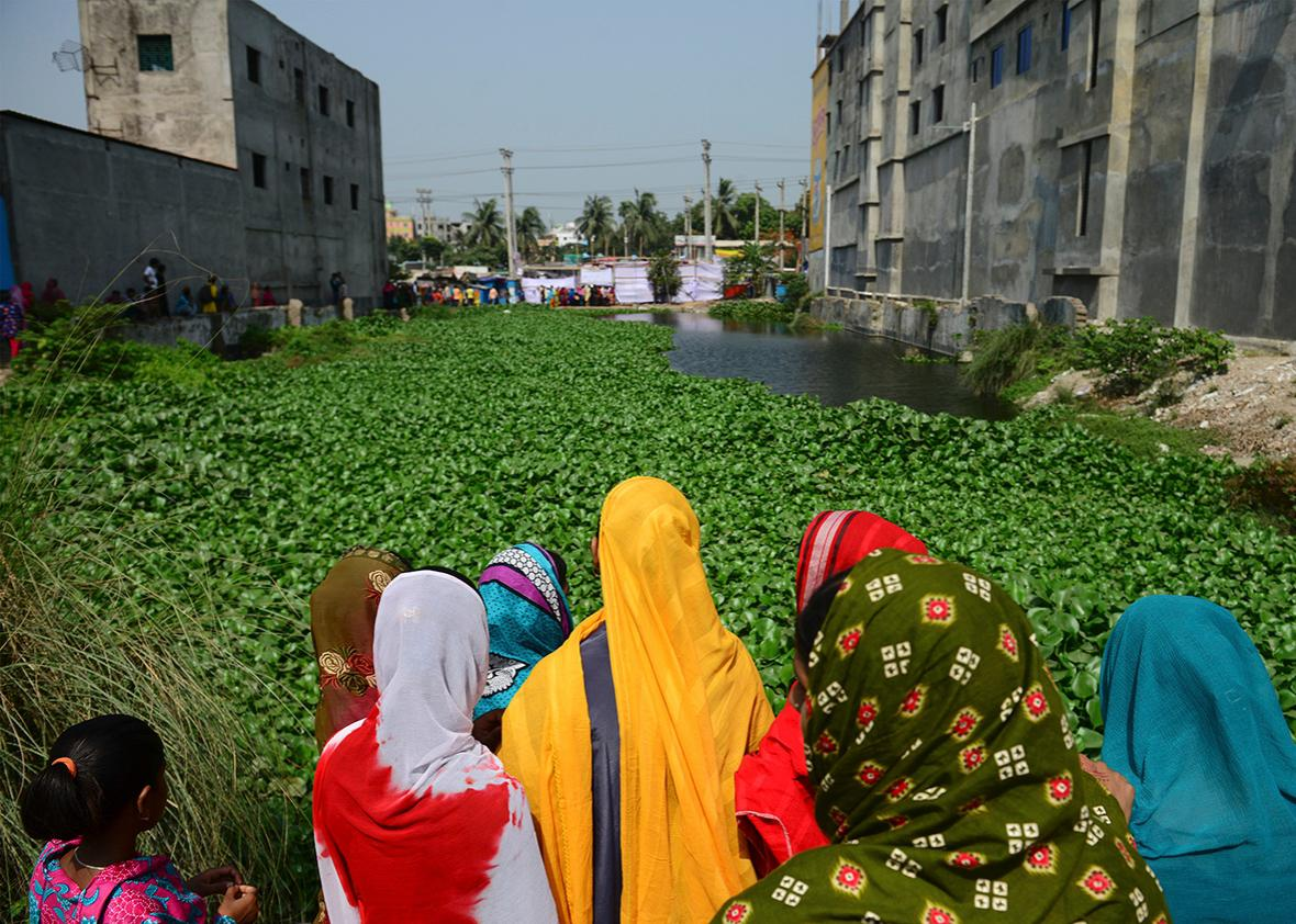 Bangladeshi onlookers gather at the site of the Rana Plaza building collapse on the third anniversary of the disaster in Savar, on the outskirts of Dhaka on April 24, 2016.