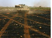 Israeli armored forces operate against Hezbollah gunmen. Click image to expand.