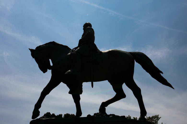 The statue of Robert E Lee on horseback is seen on a bright, sunny day.