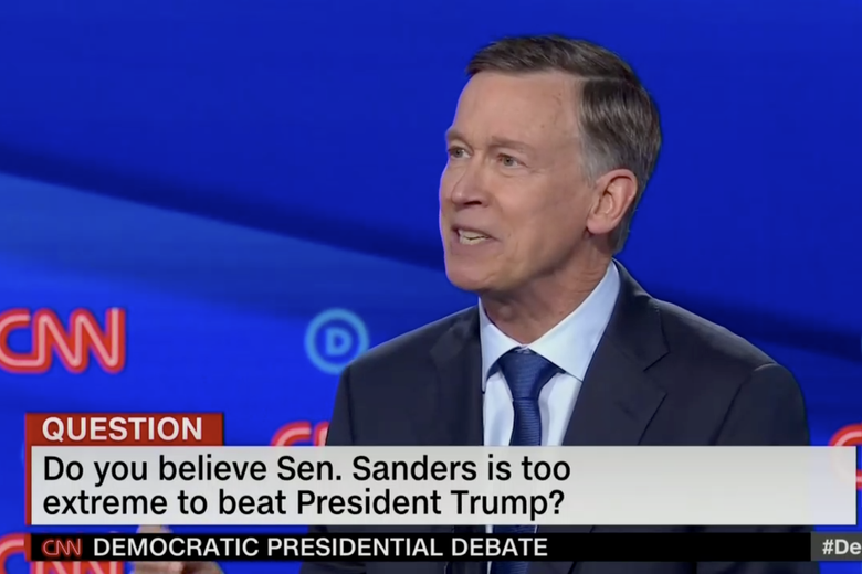 "In this screengrab from CNN, John Hickenlooper debates. The banner reads: ""Do you believe Sen. Sanders is too extreme to beat President Trump?"""