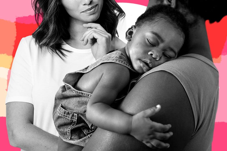 Two women looking at each other, one holding a sleeping baby in her arms.