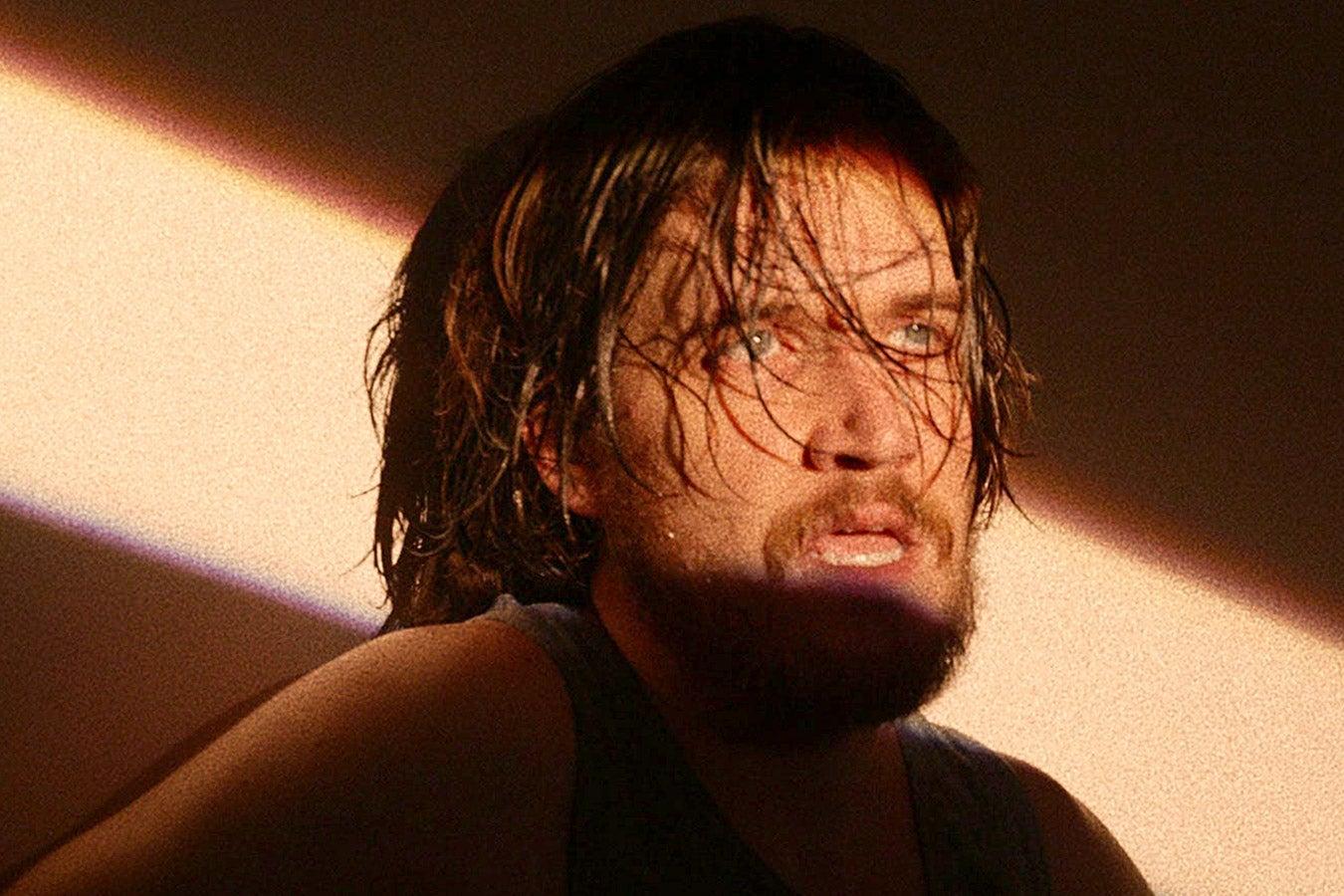 Bo Burnham with overgrown hair and a beard.