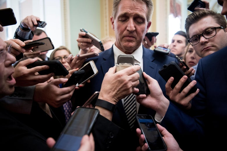 Senator Jeff Flake speaks with reporters after a meeting with Senate Majority Leader Senator Mitch McConnell about the Judge Brett Kavanaugh nomination on Capitol Hill on September 28, 2018 in Washington, DC.