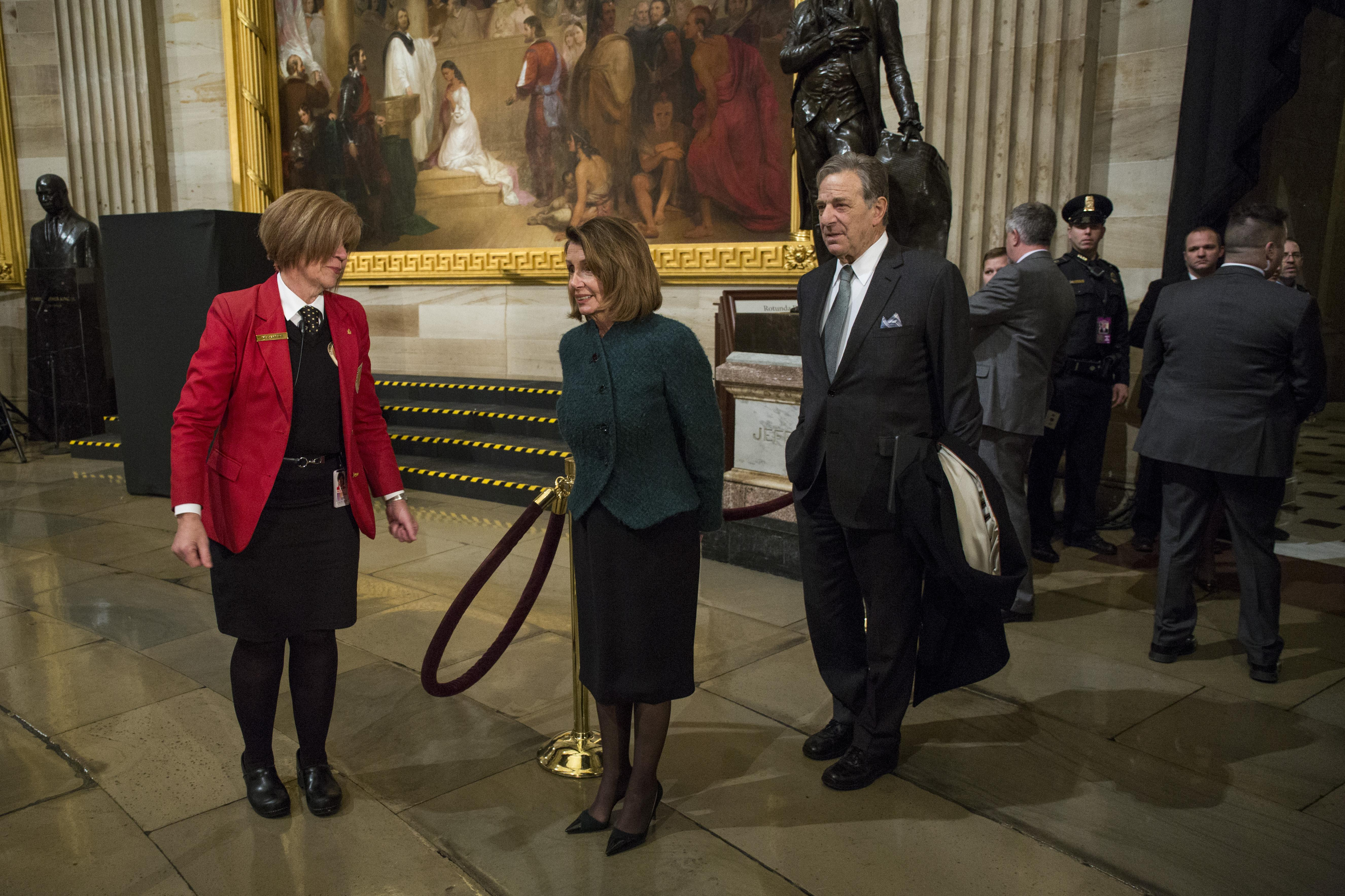 House Minority Leader Nancy Pelosi visits the Capitol Rotunda as former U.S. President George H.W. Bush lies in state on Monday in D.C.