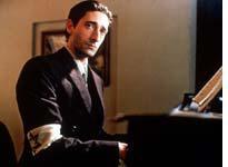 Pianist Wladyslaw Szpilman watches as his people perish