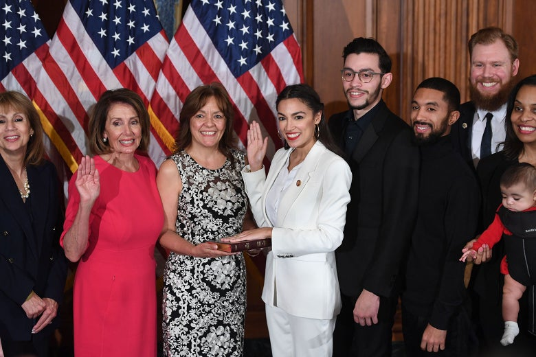 Speaker of the House Nancy Pelosi performs a ceremonial swearing-in for New York Rep. Alexandria Ocasio-Cortez.