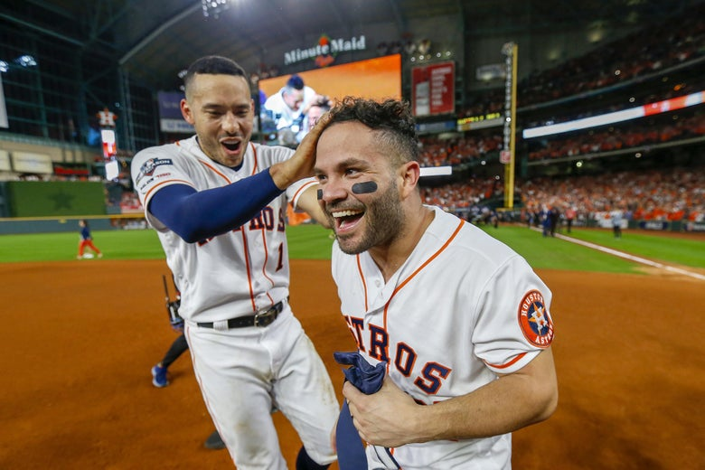 HOUSTON, TEXAS - OCTOBER 19:  Jose Altuve #27 of the Houston Astros is congratulated by his teammate Carlos Correa #1 following his ninth inning walk-off two-run home run to defeat the New York Yankees 6-4 in game six of the American League Championship Series at Minute Maid Park on October 19, 2019 in Houston, Texas. The Astros defeated the Yankees 6-4. (Photo by Elsa/Getty Images)