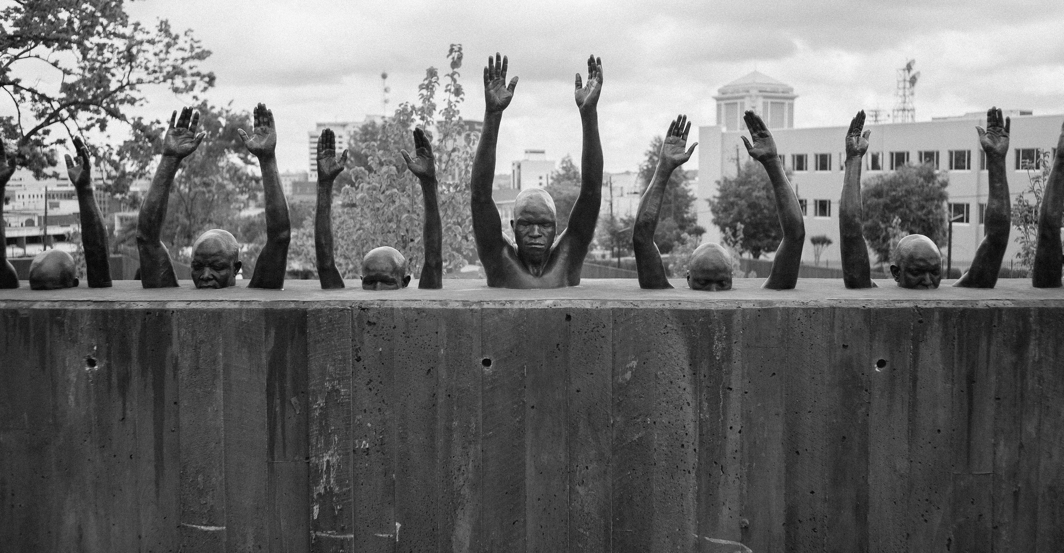 "A sculpture, titled ""Raise Up,"" that is meant to echo the ""hands up, don't shoot"" motion of Black Lives Matter protests."