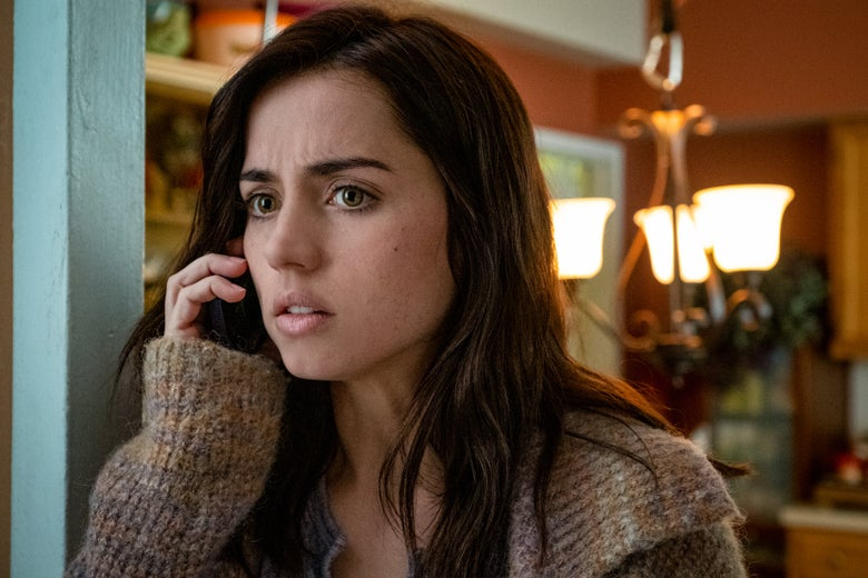 Ana de Armas holds a phone to her ear.