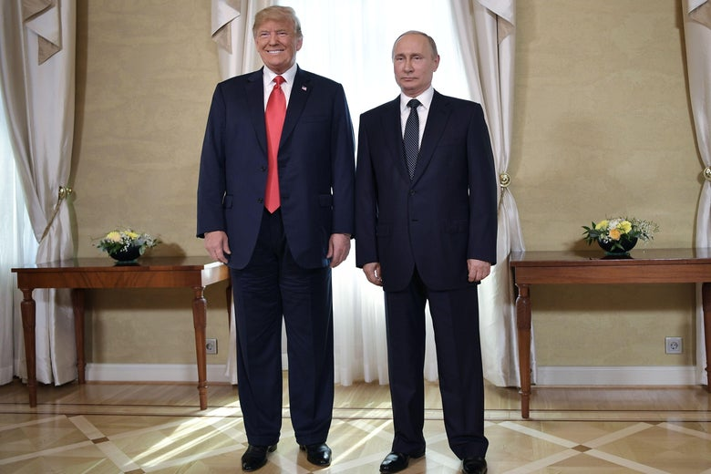 President Donald Trump and Russia's President Vladimir Putin pose ahead a meeting in Helsinki, on July 16, 2018.