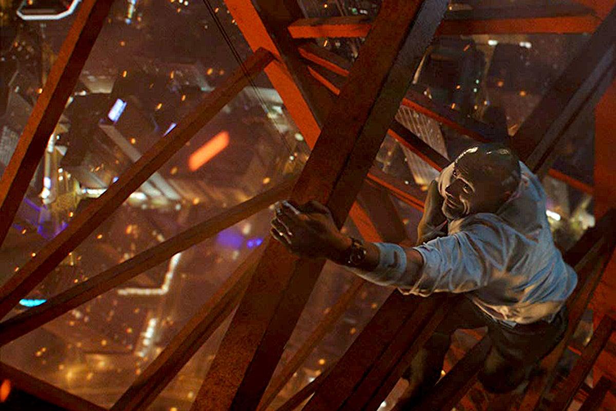 Dwayne Johnson scales a crane in Skyscraper.