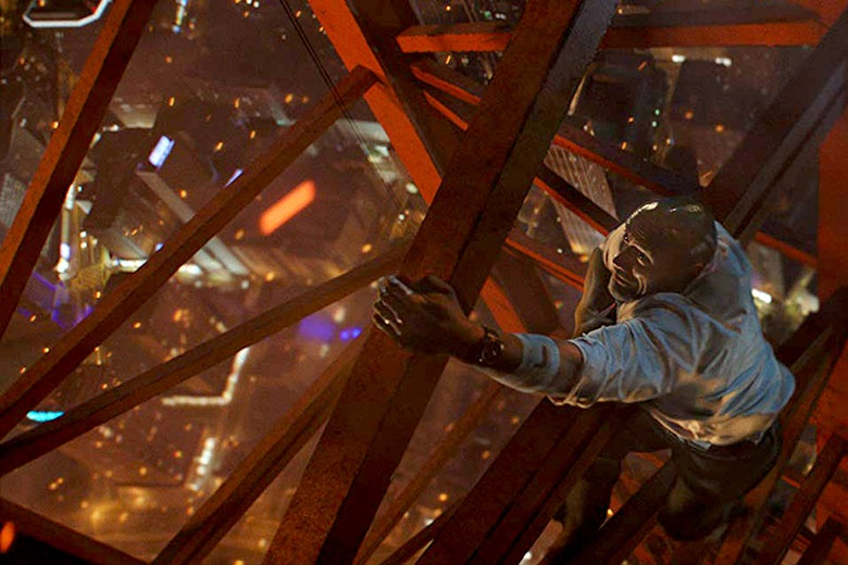 Dwayne Johnson scales a crane in Skyscraper.