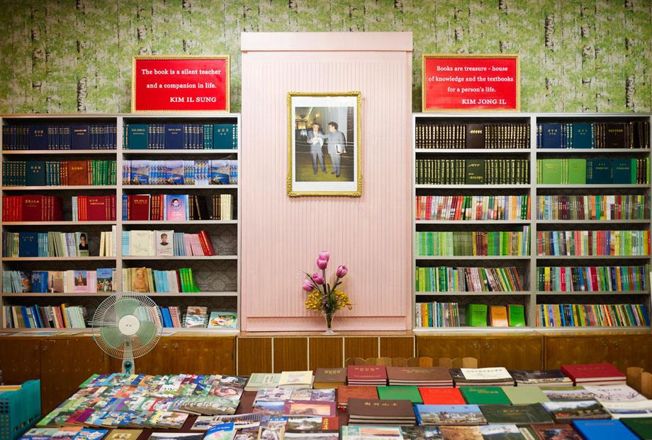 """Bookstore in a hotel in Hamhung, South Hamgyŏng province,  with quotes by Kim il-Sung """"The book is a silent teacher and a companion in life."""" and Kim Jong Il: """"Books are treasure - house of knowledge and the textbooks for a person's life:"""""""
