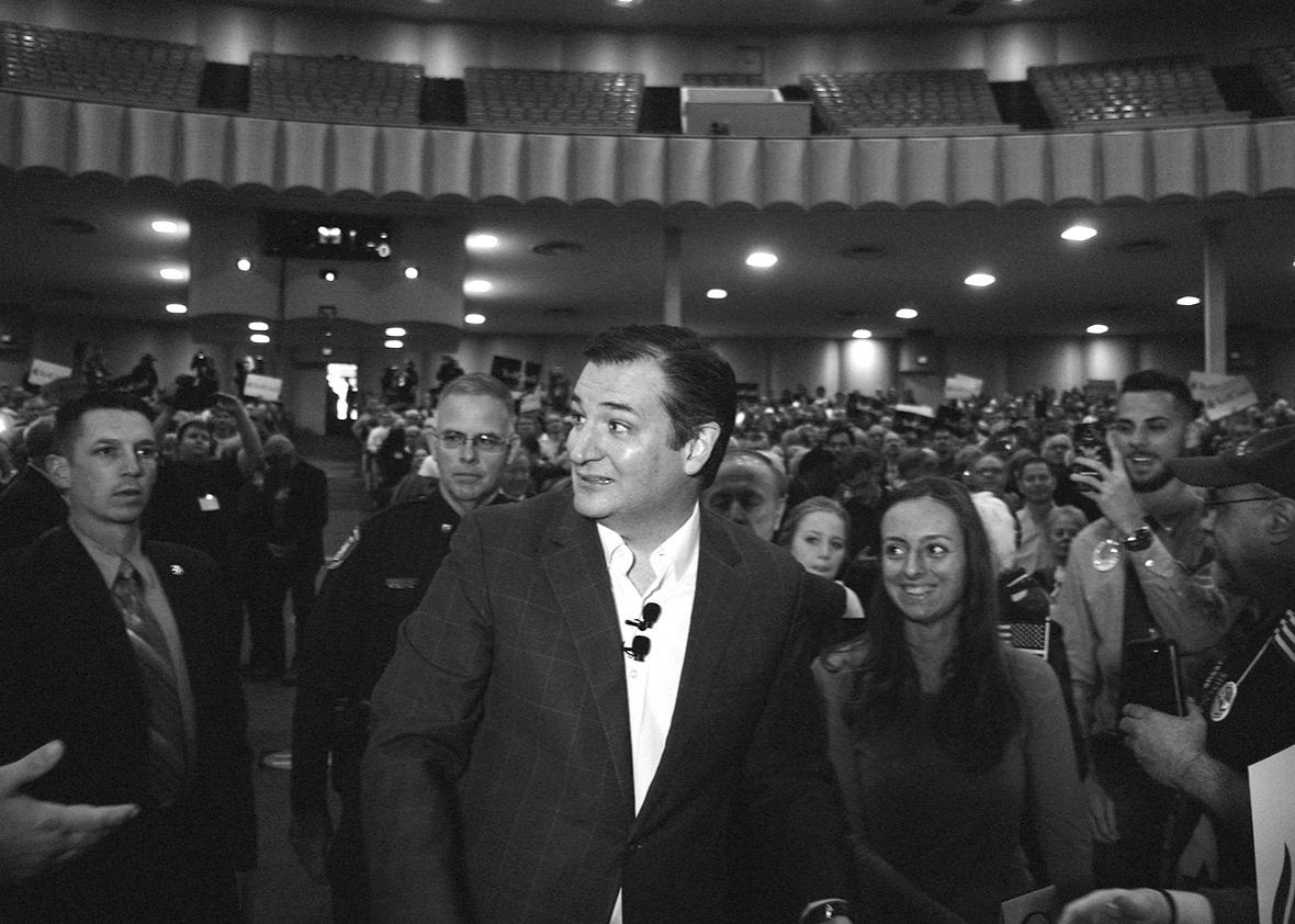After shaking hands with audience members, Cruz heads to the sta