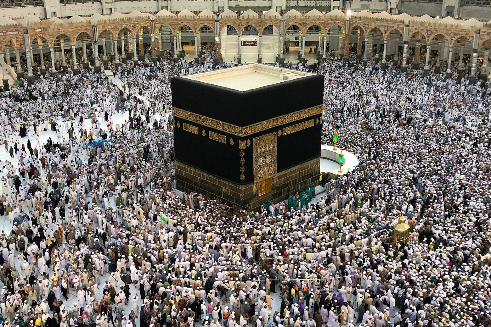 Muslim worshippers pray and circumambulate around the Kaaba.