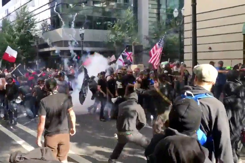 Protesters of the right-wing group Patriot Prayer clash with protesters from anti-fascist groups during a demonstration in Portland, Oregon, on June 30, 2018, in this still image taken from video from obtained from social media.