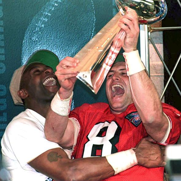 San Francisco 49ers quarterback Steve Young (R) and teammate Jerry Rice (L)