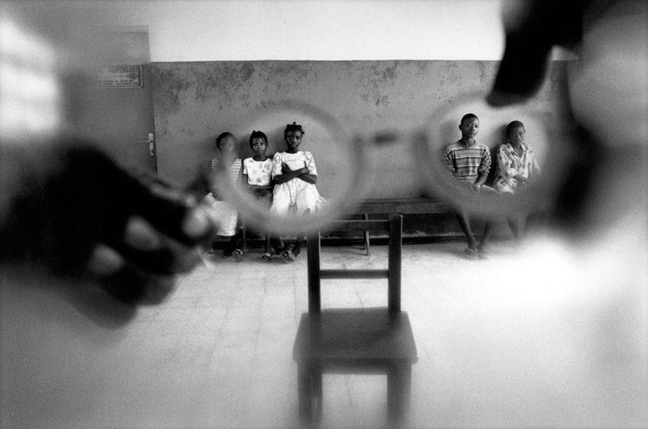 Untitled, 1999–2003. Children come to a clinic to have their eyes tested. Many people developed eye problems during the civil war in Sierra Leone because access to health care became too difficult. During a ceasefire in 1999, Bo hospital opened up a clinic to treat those who were suffering from such conditions. October 1999.