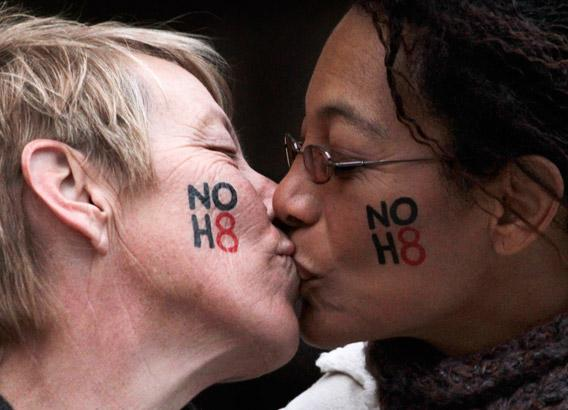Lori Campbell (L) and Maja Roble, who are engaged, kiss at a celebration rally for Tuesday's ruling on Proposition 8 in West Hollywood, California February 7, 2012.
