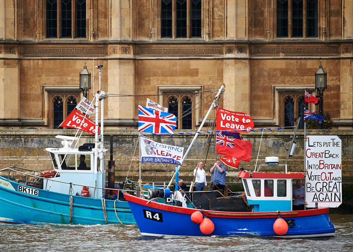 "Boats decorated with flags and banners from the 'Fishing for Leave' group that are campaigning for a 'leave' vote in the EU referendum sail by the British Houses of Parliament as part of a ""Brexit flotilla' on the river Thames in London on June 15, 2016."