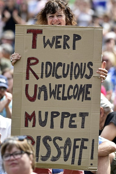 A protester holds up a placard as she takes part in the Scotland United Against Trump demonstration through the streets of Edinburgh, Scotland on July 14, 2018.