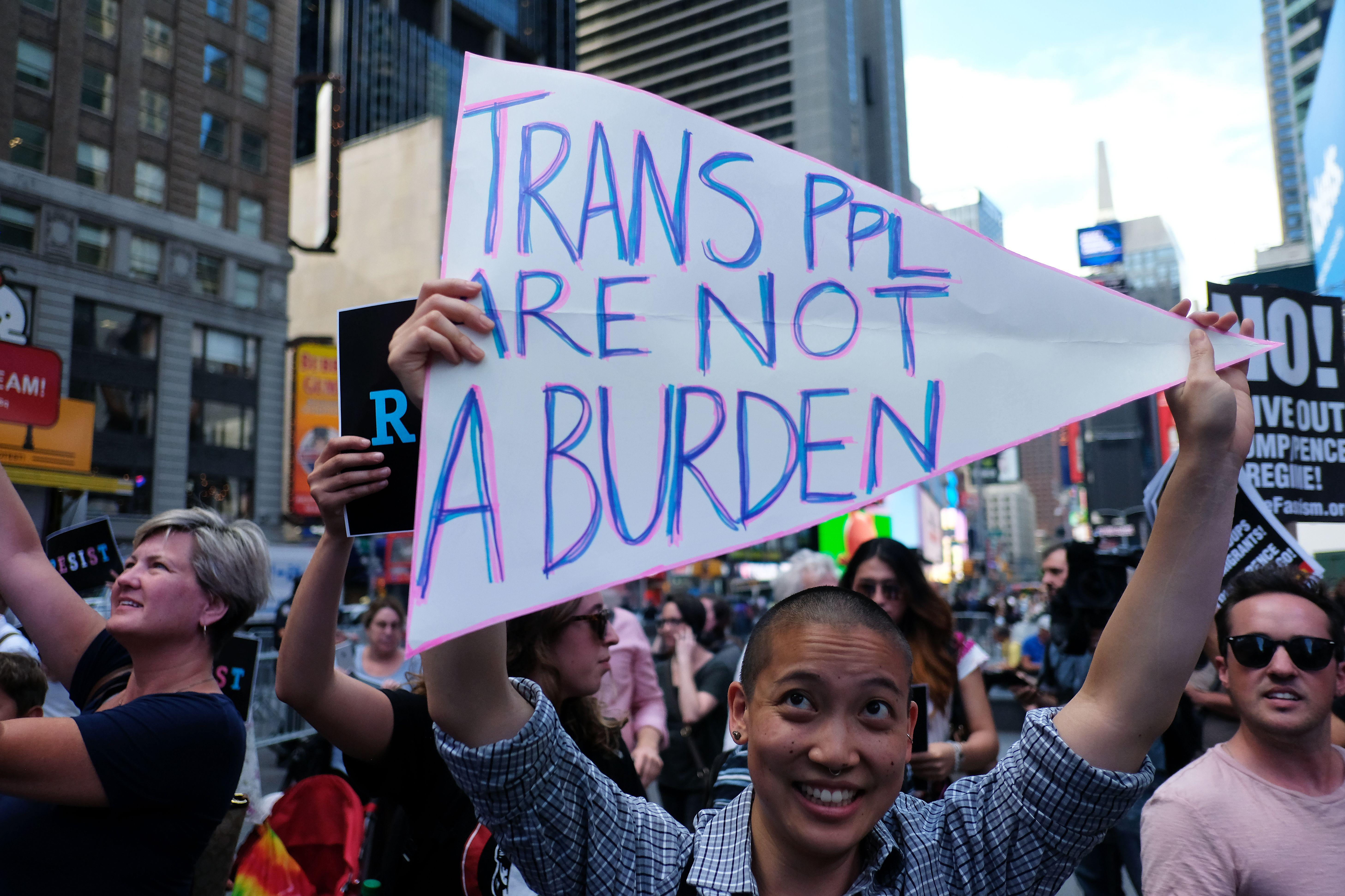 Protesters demonstrate against President Donald Trump's plan to ban open transgender military service.