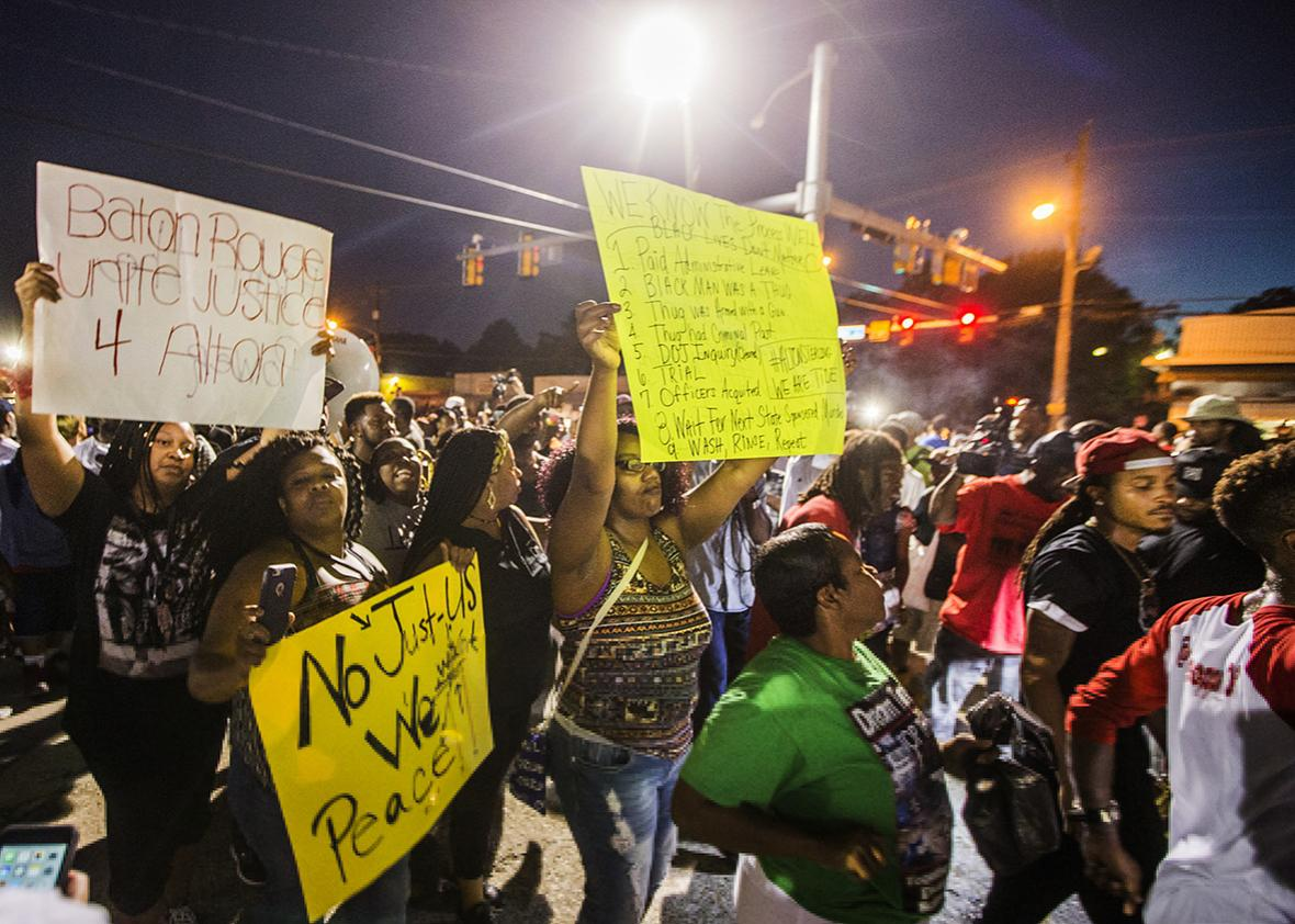 Protesters march to the convenience store where Alton Sterling was shot and killed, July 6, 2016 in Baton Rouge, Louisiana.