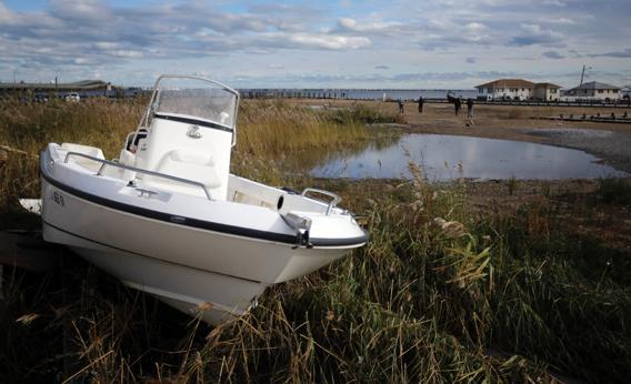 A damaged boat is shown in the wake of superstorm Sandy, Oct. 31, 2012, in Toms River, N.J.