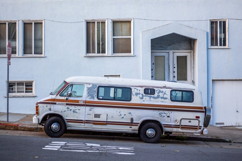 A van is parked in front of a building in San Francisco.