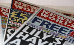 Copies of Britain's News of the World newspaper. Click image to expand.
