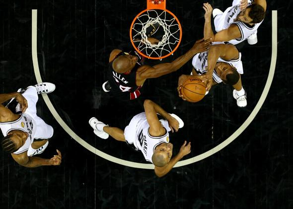 Boris Diaw of the San Antonio Spurs goes to the basket against Ray Allen of the Miami Heat during game five of the 2014 NBA Finals at the AT&T Center on June 15, 2014, in San Antonio