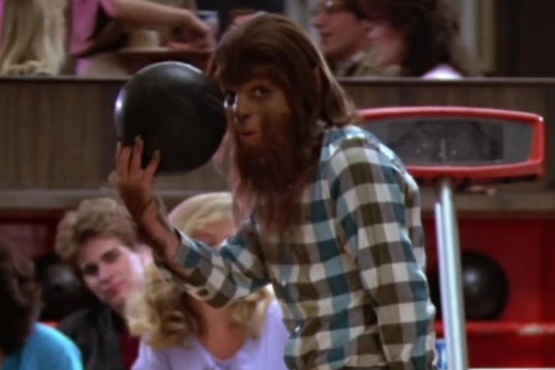 In a still from Teen Wolf, Michael J. Fox, dressed as a werewolf, prepares to bowl.