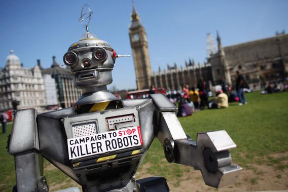 A robot distributes promotional literature calling for a ban on fully autonomous weapons in Parliament Square on April 23, 2013, in London. The Campaign to Stop Killer Robots is calling for a pre-emptive ban on lethal robot weapons that could attack targets without human intervention.