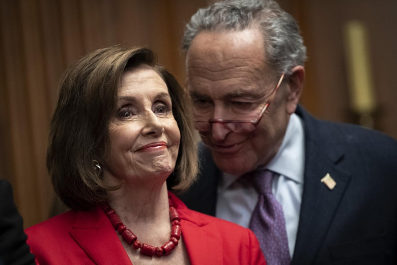 House Speaker Nancy Pelosi and Senate Minority Leader Chuck Schumer speak with each other at a news conference at the U.S. Capitol on November 12, 2019 in Washington, D.C.