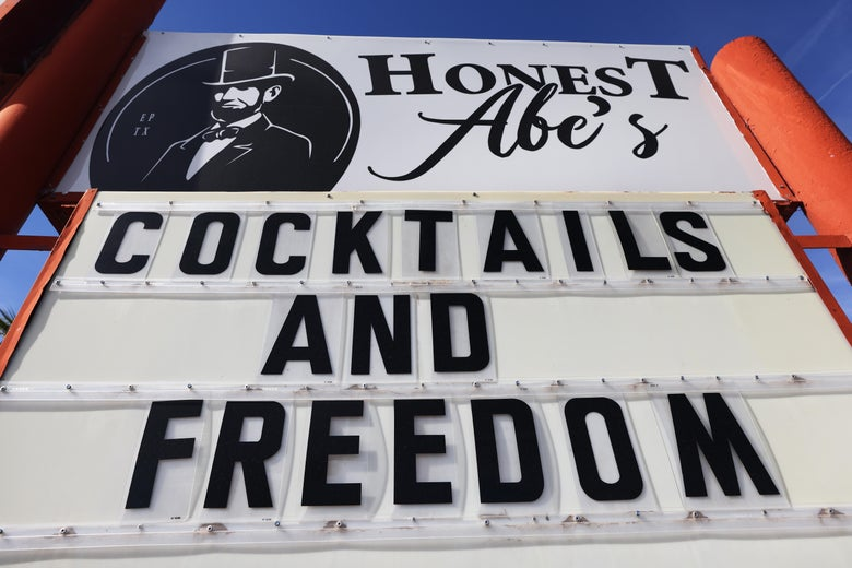 """Marquee outside Honest Abe's bar that says """"Cocktails and Freedom."""""""