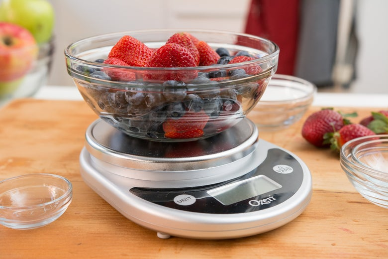 Bowl of fruit on the kitchen scale.