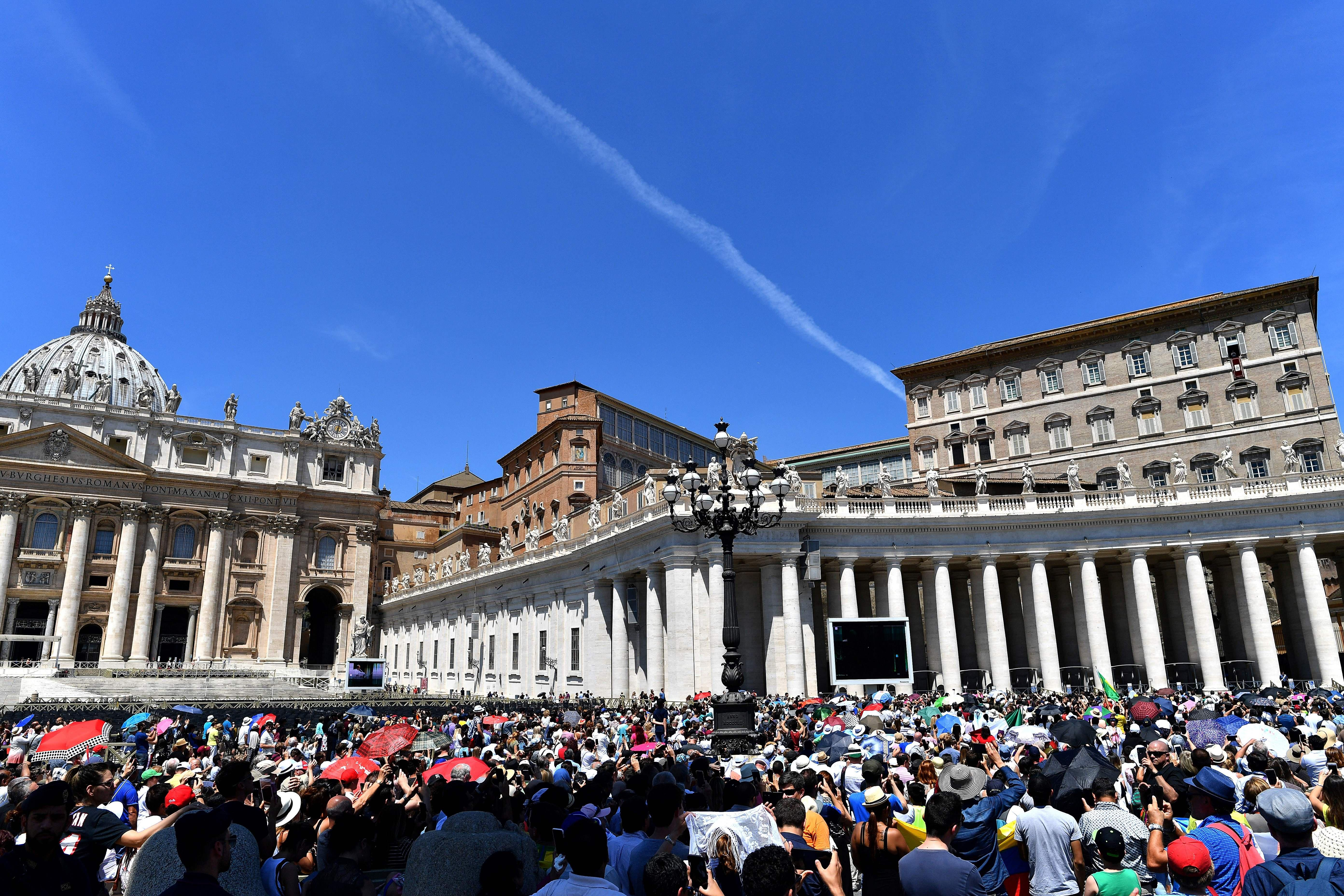 Pope Francis addresses the crowd from the window of the apostolic palace overlooking St Peter's square during his Angelus prayer on June 17, 2018 at the Vatican.