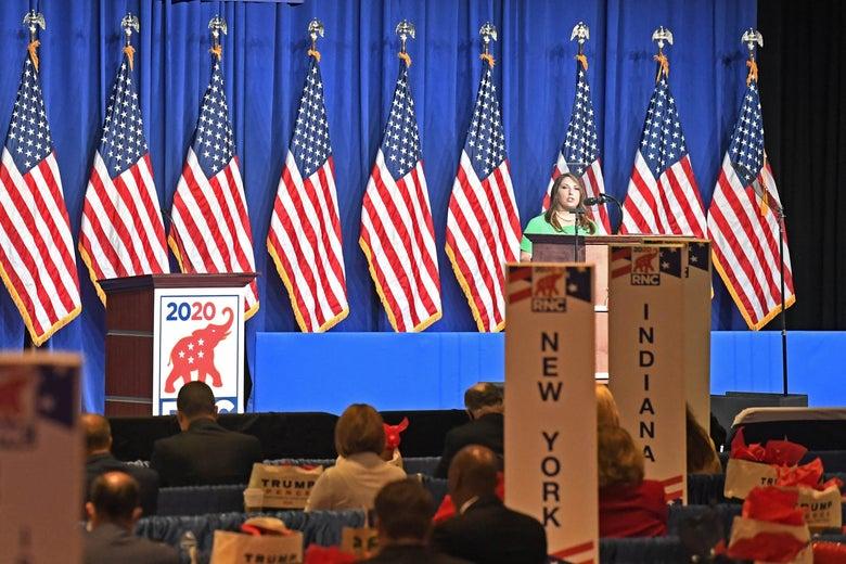 RNC Chairwoman Ronna McDaniel speaks behind a podium.