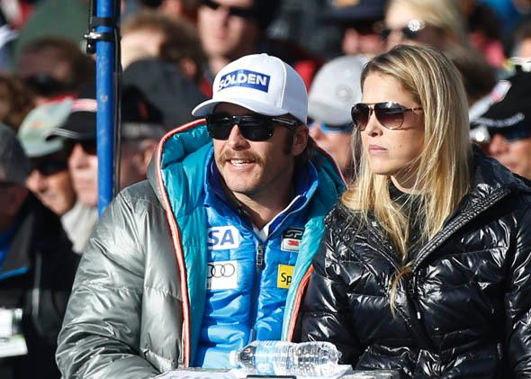 Bode Miller, U.S. alpine World Cup ski racer, watches the men's World Cup downhill ski race with his wife Morgan Beck in Beaver Creek, Colorado November 30, 2012.