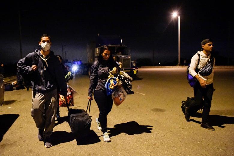 Venezuelan migrants cross the border between Ecuador and Peru in Tumbes, Peru, on August 25, 2018.
