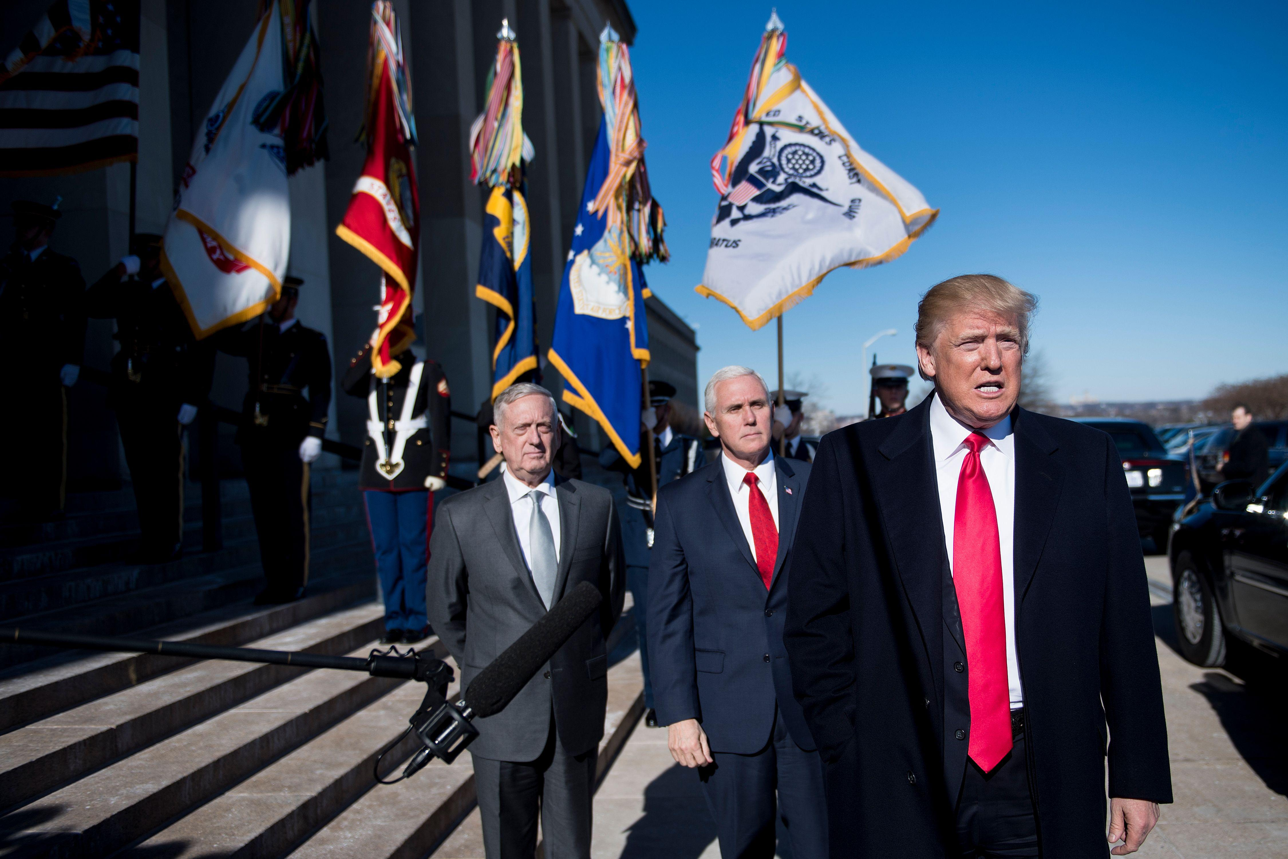 Secretary of Defense James Mattis, left, and Vice President Mike Pence, center, listen while President Donald Trump speaks before a meeting in the Pentagon.