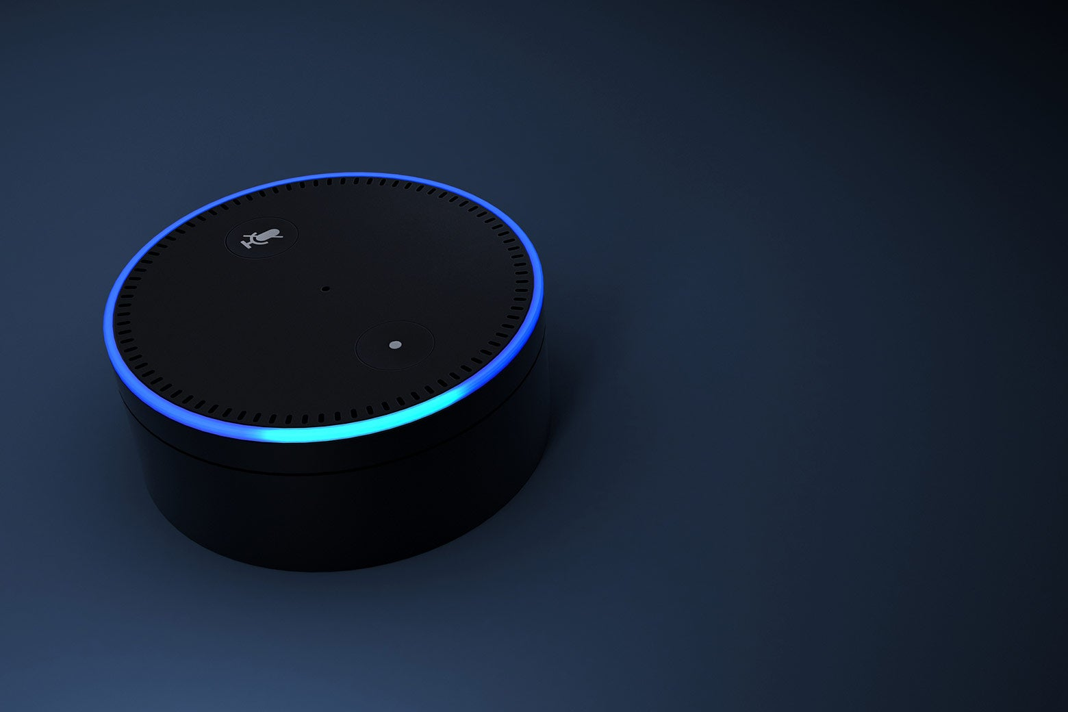 An Echo Dot's ring is lit up, indicating that it's listening.